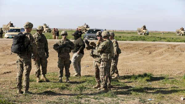 US-led coalition instructors monitor as they train Iraqi soldiers from the army's 72nd infantry brigade while participating in a joint live ammunition exercise at Besmaya military base in south of Baghdad, Iraq, January 27, 2016. - Sputnik International