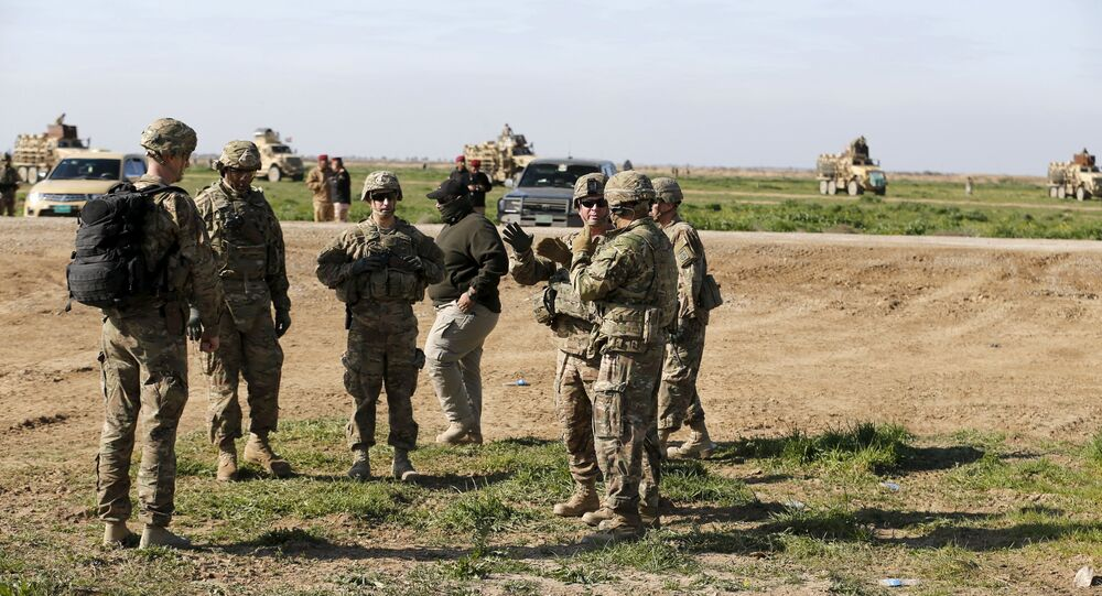 US-led coalition instructors monitor as they train Iraqi soldiers from the army's 72nd infantry brigade while participating in a joint live ammunition exercise at Besmaya military base in south of Baghdad, Iraq, 27 January 2016.