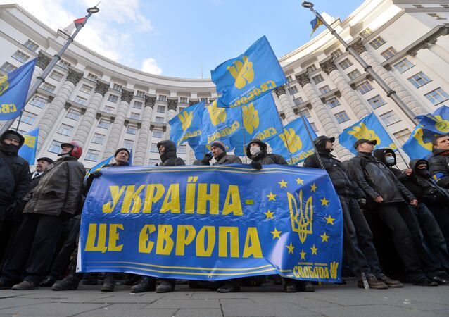 Protesters hold a placards reading Ukraine is Europe
