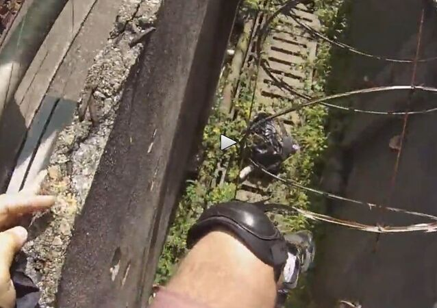 BASE jumper lands hard in razor wire