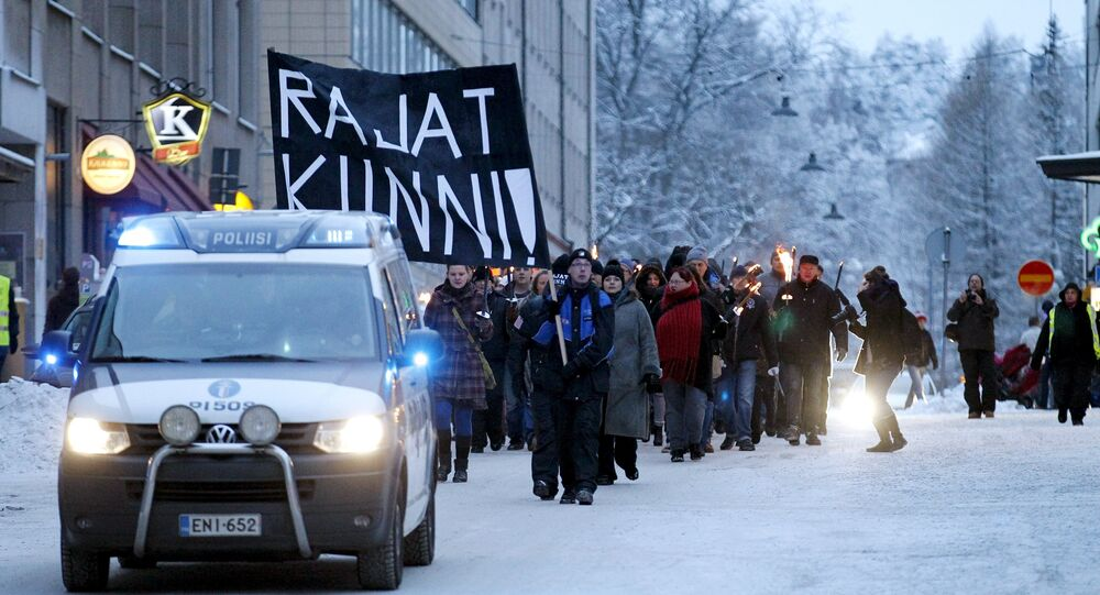 Anti-immigration marchers are led by a police van on the streets in Tampere, Finland January 23, 2016. On the northern fringes of Europe, Finland has little history of welcoming large numbers of refugees, unlike neighbouring Sweden. But as with other European countries, it is now struggling with a huge increase in asylum seekers and the authorities are wary of any anti-immigrant vigilantism.