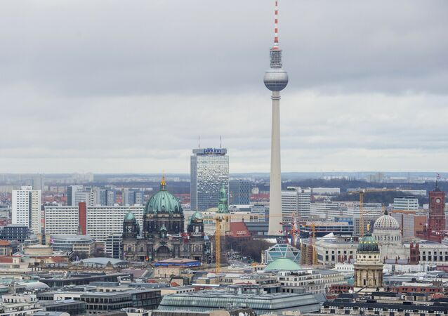 View of the Berlin skyline seen from Potsdamer Platz to Alexanderplatz, including the TV Tower, the Berlin Cathedral (R), the Berlin palace under construction, and the city's town hall (Rotes Rathaus, R)