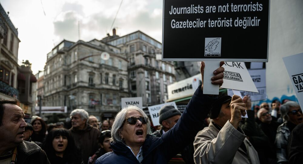 Journalists and Turkish intellectuals shout slogans during a demonstration on December 26, 2015 in Istanbul, following the arrest of Cumhuriyet newspaper's Editor in Chief