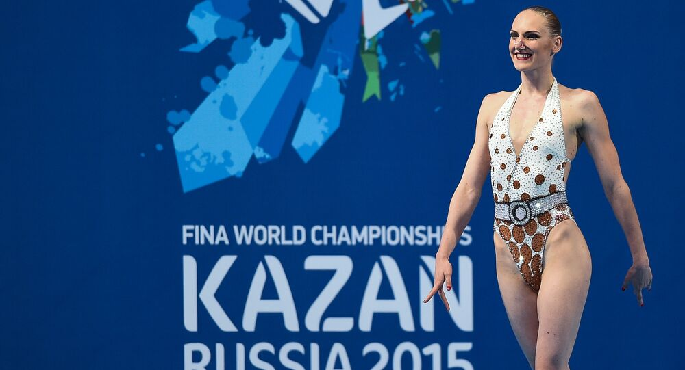 Svetlana Romashina of Russia performs her technical program during the synchronized swimming competition at the 2015 FINA World Championships in Kazan