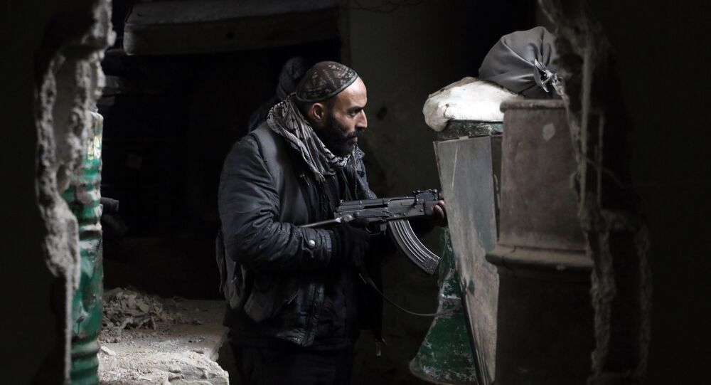 A fighter from the Jaish al-Islam (Islam Army), the foremost rebel group in Damascus province guards a position on the front line in Jobar, on the eastern edge of the Syrian capital