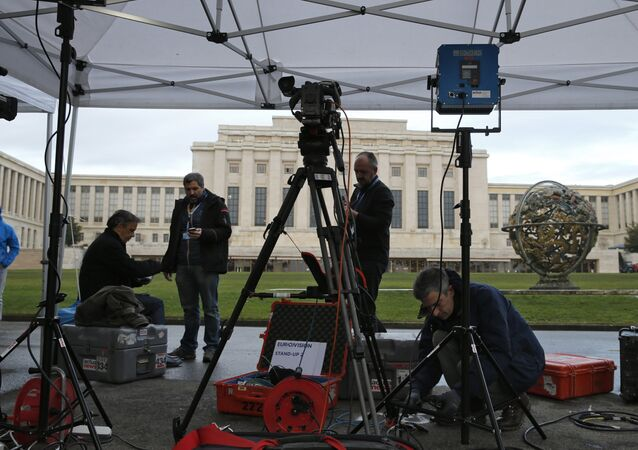 A television crew sets up ahead of the start of Syrian talks in front of the United Nations European headquarters in Geneva, Switzerland, January 29, 2016