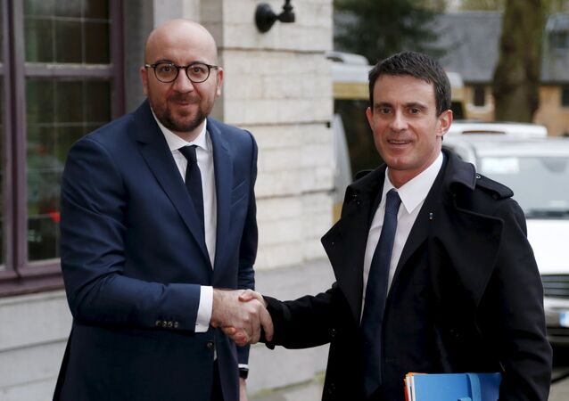 Belgian Prime Minister Charles Michel welcomes his French counterpart Manuel Valls ahead of a meeting to find a common front on security challenges at Val Duchesse castle in Brussels, Belgium, February 1, 2016.