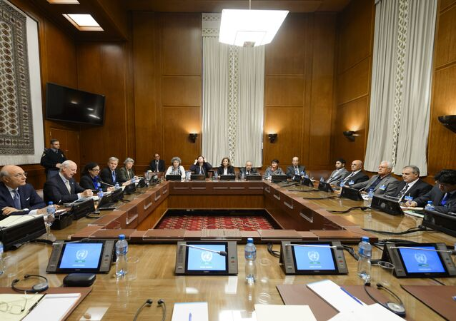 United Nations (UN) special envoy Staffan de Mistura (2nd L) sits facing Syria's main opposition group during Syrian peace talks at the UN Offices in Geneva on February 1, 2016