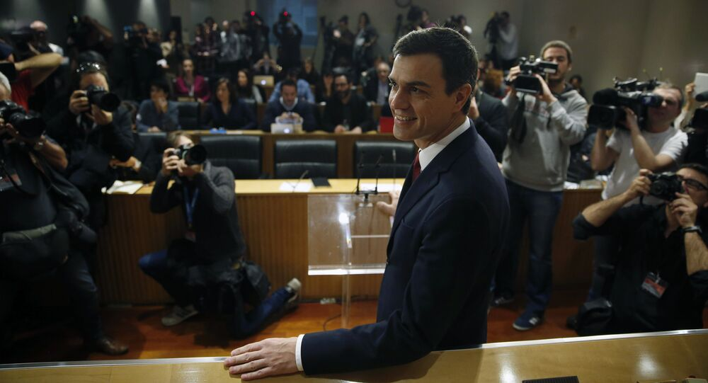 Spain's Prime Minister and Socialist Party (PSOE) leader Pedro Sanchez poses before a news conference at Parliament in Madrid, Spain, February 2, 2016.