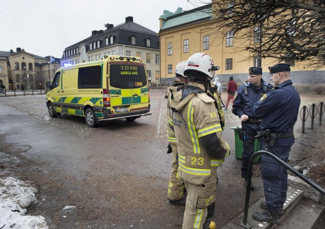 Emergency personnel stand outside a school after a loud explosion was heard on 2 February 2016 in the centre of Karlstad in Sweden.