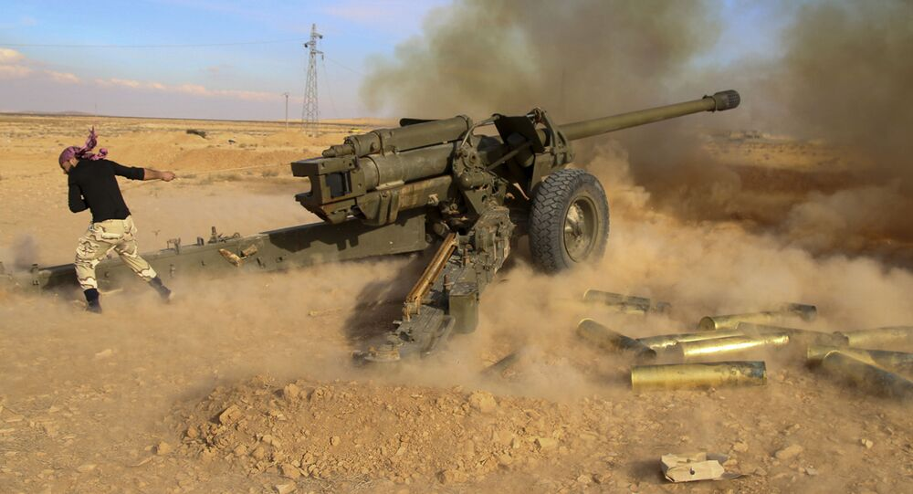 In this photo taken on Saturday, Jan. 30, 2016, Syrian government troops fire at Daesh group positions near Mahin, Syria