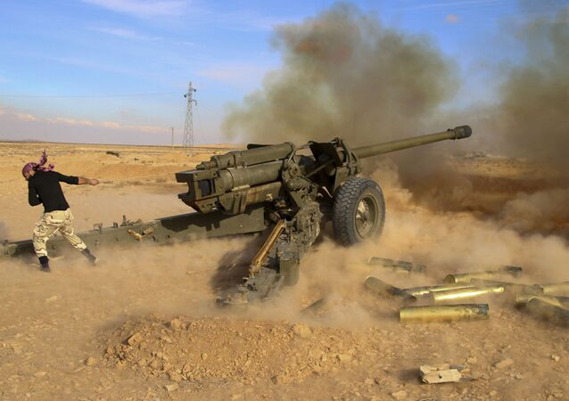 In this photo taken on Saturday, Jan. 30, 2016, Syrian government troops fire at Islamic State group positions near Mahin, Syria