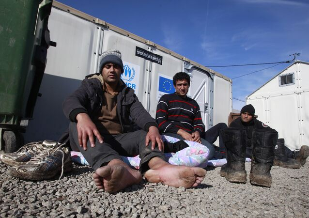 Refugees who say they come from Afghanistan, rest at the transit center for refugees near northern Macedonian village of Tabanovce, Tuesday, Feb. 2, 2016