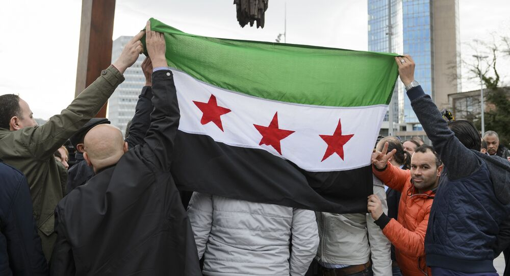 High Negotiations Committee (HNC) (Syrian opposition body) supporters hold a Syrian flag during a press conference on Syrian peace talks at the Place des Nations outside of the United Nations Offices on February 2, 2016 in Geneva.
