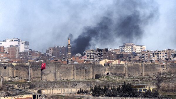 A photo taken on February 3, 2016 shows smokes rising over the district of Sur in Diyarbakir after clashes between Kurdish rebels and Turkish forces - Sputnik International