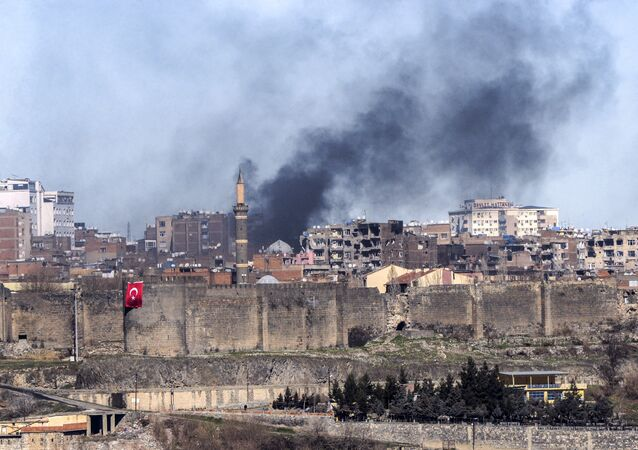 A photo taken on February 3, 2016 shows smokes rising over the district of Sur in Diyarbakir after clashes between Kurdish rebels and Turkish forces