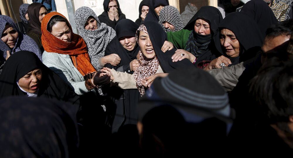 Family members weep at the funeral for one of the victims of last night suicide car bomb attack in Kabul, Afghanistan January 21, 2016