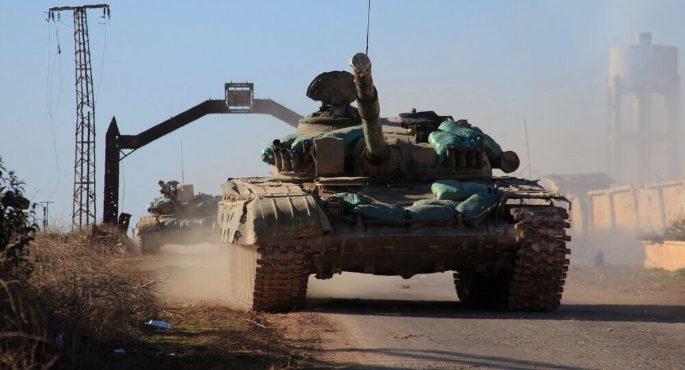 Syrian government forces' tanks drive in the village of Tal Jabin, north of the embattled city of Aleppo, as they advanced to break a three-year rebel siege of two government-held Shiite villages, Nubol and Zahraa, and take control of parts of the supply route on February 3, 2016