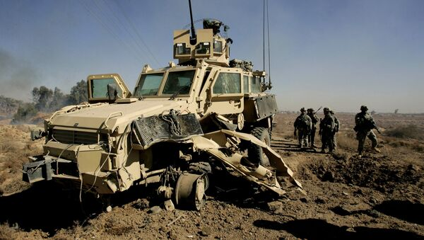 U.S. soldiers secure the area next to a damaged U.S. mine resistant, ambush protected vehicle (MRAP), after a roadside bomb explosion during an operation in the area of Al-leg, some 40 miles south of Baghdad, Iraq (File) - Sputnik International