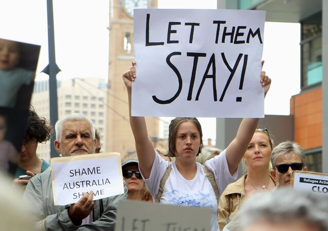 Activists hold placards and chant slogans as they protest outside the offices of the Australian Immigration Department in Sydney, Australia, February 4, 2016