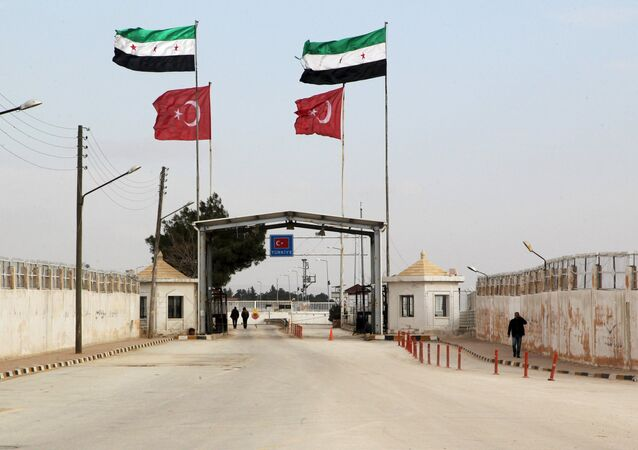 Free Syrian Army and Turkish flags flutter over the Bab Al-Salam border crossing, that is closed from the Turkish side, activists said, in northern Aleppo countryside, Syria, January 18, 2016