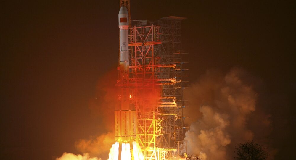 In this photo released by the Xinhua news agency, an orbiter is launched by a Long March-3III carrier rocket from the Xichang Satellite Launch Center in southwest China's Sichuan Province, on Sunday Jan. 17, 2010
