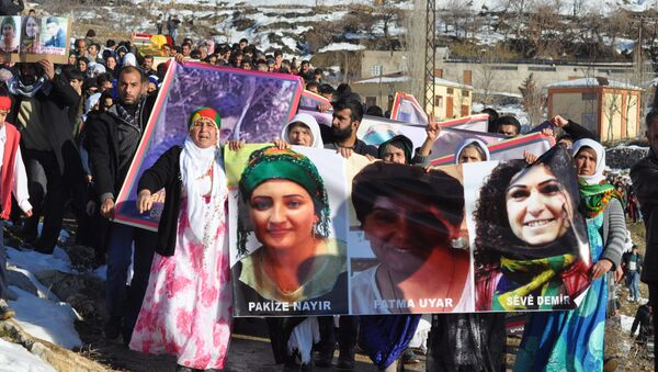 People hold pictures of victims from Cizre and Silopi killed during curfews during a funeral on January 12, 2016, in Sirnak - Sputnik International