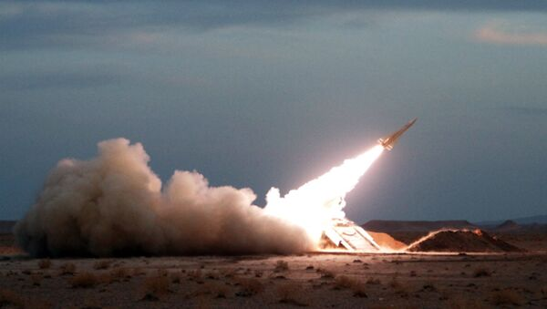 A Hawk surface-to-air missile is launched during military maneuvers at an undisclosed location in Iran on November 13, 2012 - Sputnik International