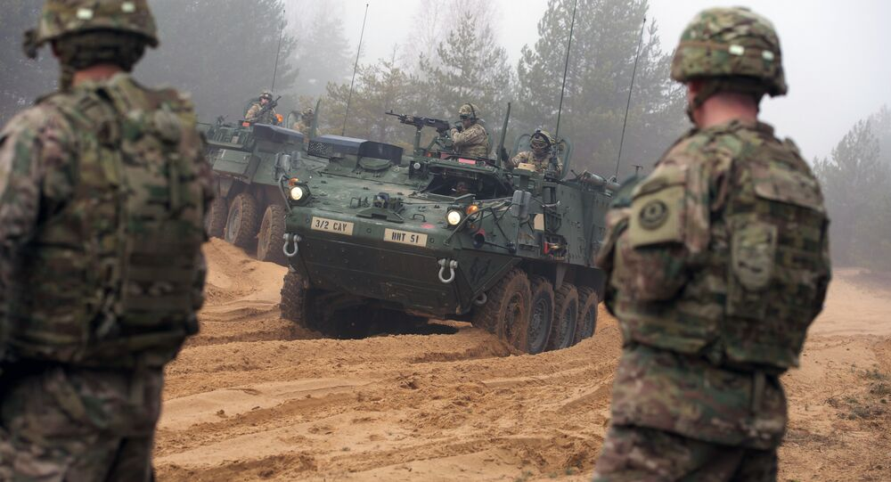 Picture taken on February 26, 2015 shows armored fighting vehicles IAV Stryker of the US Cavalry Regiment 2nd subdivision during training with Latvian an Canadian soldiers at the Adazi military training area in Latvia