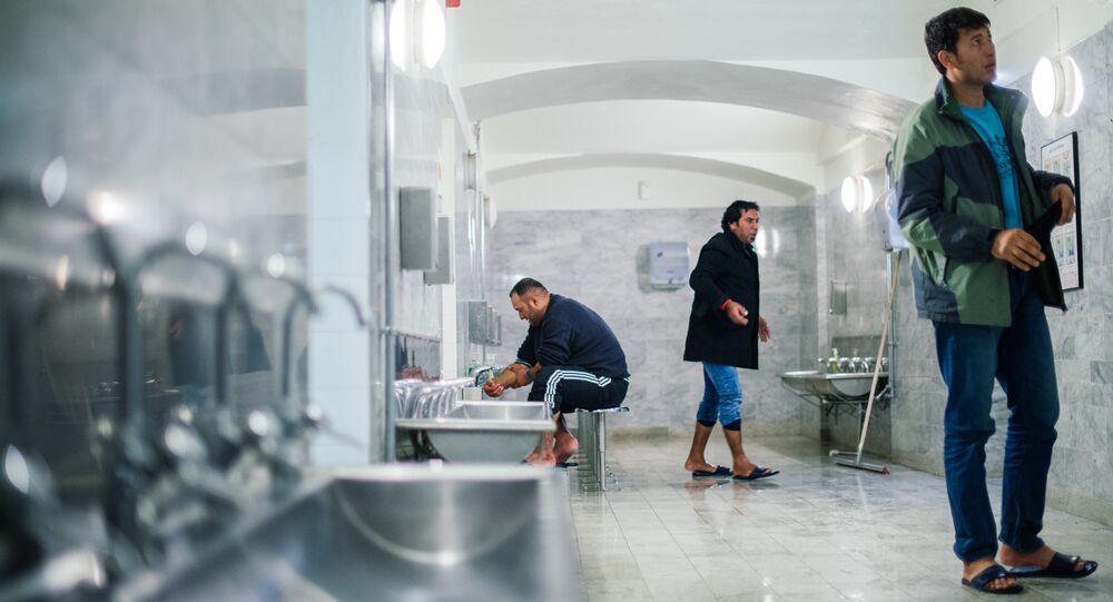 Refugee's wash their feet and refresh at Stockholm central mosque bathroom on October 15, 2015 after many hours bus journey from the southern city of Malmo