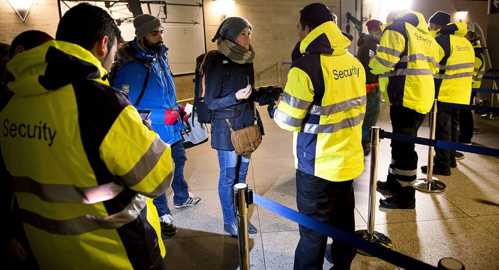 Security checks travelers IDs on January 4, 2016 at the train station in Kastrup (Denmark), the last stop before Sweden.