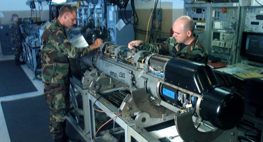 Tech. Sgt. Brad Mikula (left) and Staff Sgt. Jesse Marshall inspect an electronic countermeasures pod here