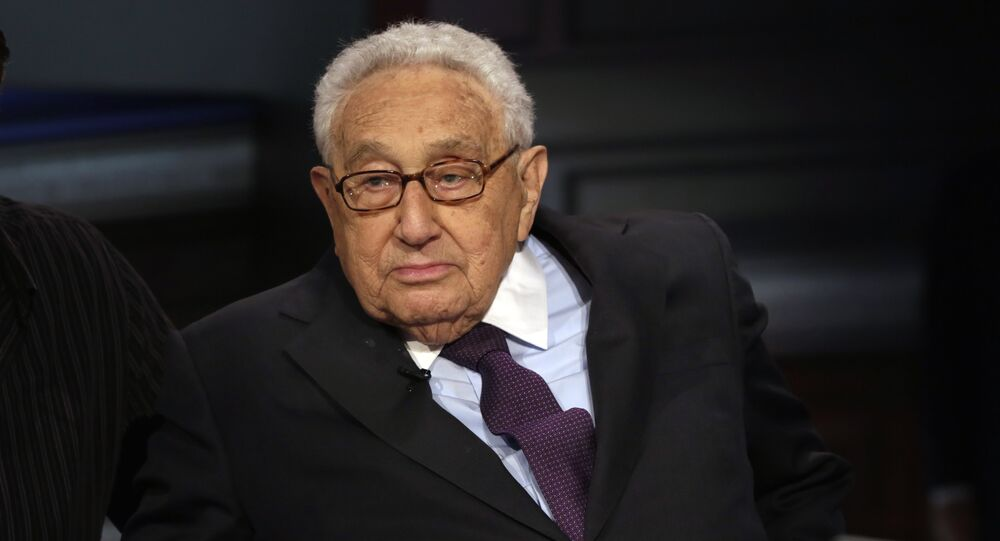 Former U.S. Secretary of State Henry Kissinger is interviewed by Neil Cavuto on his Cavuto Coast to Coast program, on the Fox Business Network, in New York, Friday, June 5, 2015