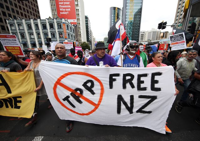 Protesters march to the venue of the Trans Pacific Partnership Agreement signing, SkyCity Conference Centre, Auckland, New Zealand, Thursday, Feb 4, 2016.