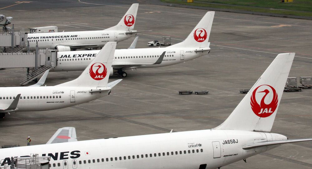 This picture taken on April 29, 2014 shows Japanese air carrier Japan Airlines planes parked on the tarmac at Tokyo's Haneda airport