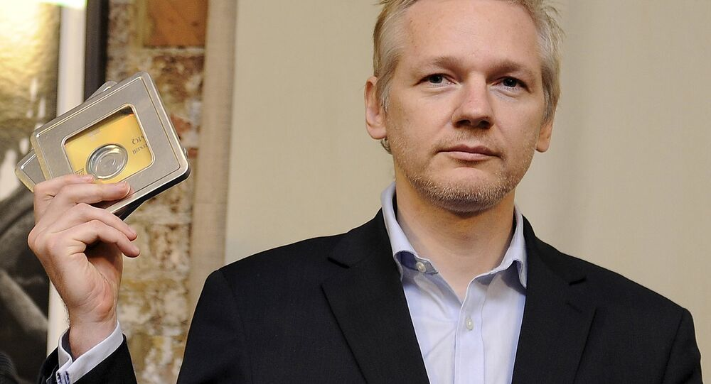 WikiLeaks founder Julian Assange holds up CD's containing data on offshore bank account holders, which he received from former Swiss private banker Rudolf Elmer at the Frontline club in London, Britain in this January 17, 2011 file photo