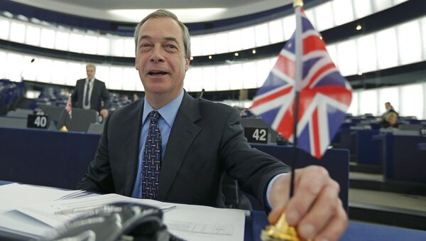 Nigel Farage, leader of the United Kingdom Independence Party (UKIP) and Member of the European Parliament, holds a British Union Jack flag as he arrives to take part in a debate on the upcoming summit and EU referendum in the UK, at the European Parliament in Strasbourg, France, February 3, 2016 - Sputnik International