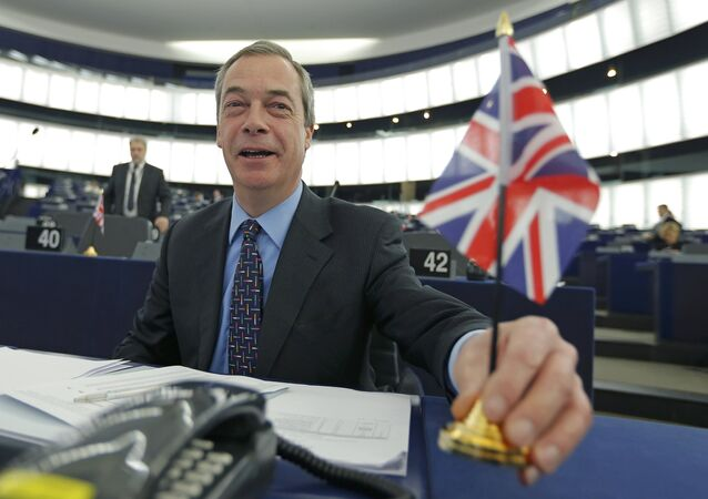 Nigel Farage, leader of the United Kingdom Independence Party (UKIP) and Member of the European Parliament, holds a British Union Jack flag as he arrives to take part in a debate on the upcoming summit and EU referendum in the UK, at the European Parliament in Strasbourg, France, February 3, 2016