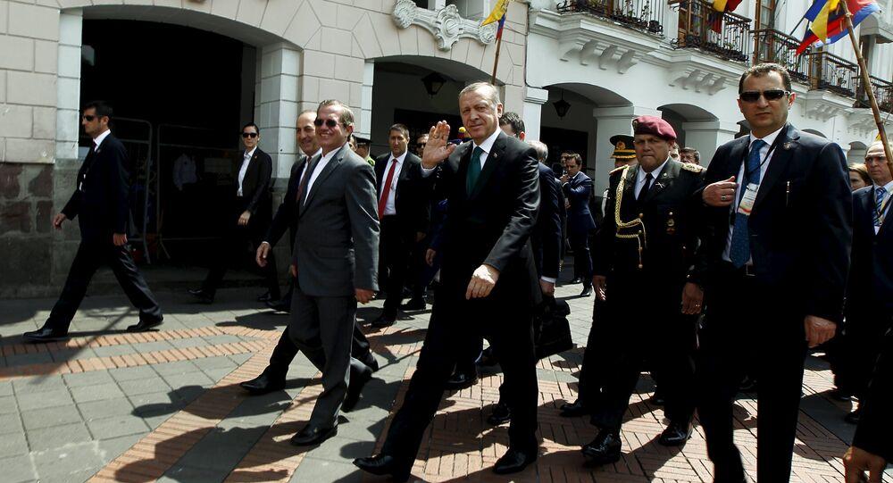 Turkish President Tayyip Erdogan waves next to Ecuador's Foreign Affairs Ricardo Patino while walking into Carondelet Palace in Quito, Ecuador, February 4, 2016