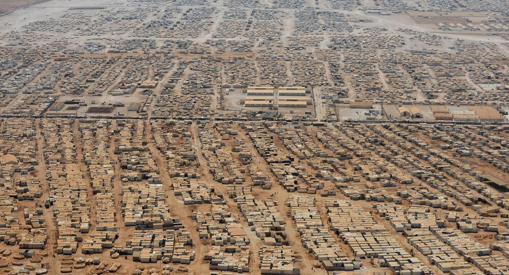 This Thursday, July 18, 2013 aerial view photo, shows the Zaatari refugee camp near the Jordanian city of Mafraq, some 8 kilometers (5 miles) from the Jordanian-Syrian border