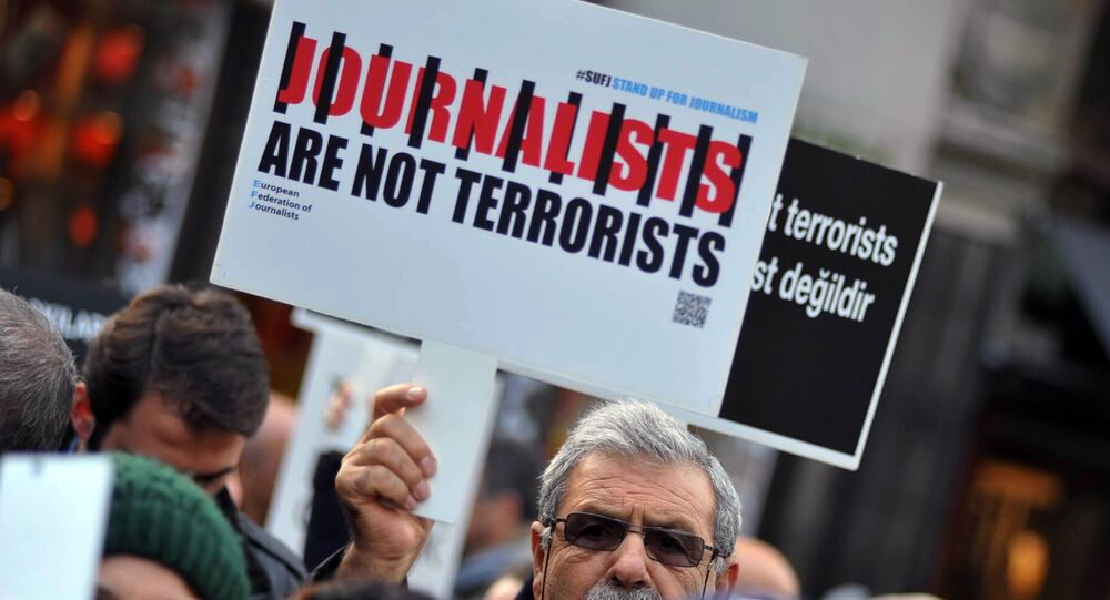 Turkish journalists gathered to protest against the jailing of opposition Cumhuriyet newspaper's editor-in-chief Can Dundar and Ankara representative Erdem Gul, in Istanbul, Saturday, Dec. 26, 2015