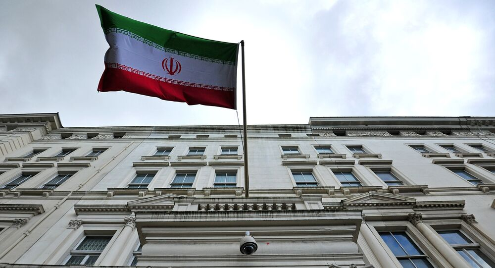 The Iranian flag hangs outside the Iranian embassy in central London on February 20, 2014