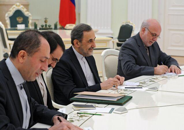 Vladimir Putin (outside frame) meets with Ali Akbar Velayati, Iranian president's special envoy and advisor for foreign affairs. File photo.