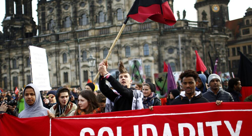 Opponents of the anti-Islam movement Patriotic Europeans Against the Islamisation of the West (PEGIDA) take part in a demonstration in Dresden, Germany
