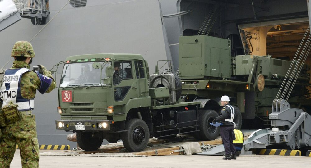A Japanese Self-Defence Forces' vehicle carrying units of Patriot Advanced Capability-3 (PAC-3) missiles leaves a port on Japan's southern island of Ishigaki, Okinawa prefecture, in this photo taken by Kyodo February 6, 2016.