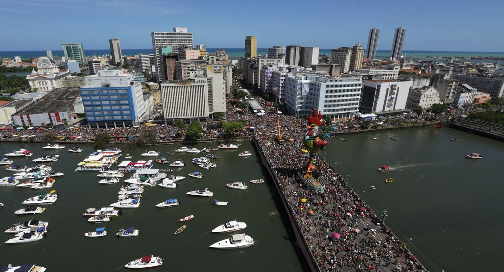 "Tens of thousands of people take part in the ""Galo da Madruga"" or The Dawn Rooster carnival parade, in downtown of Recife, Pernambuco state, Brazil, Saturday, Feb. 6, 2016"