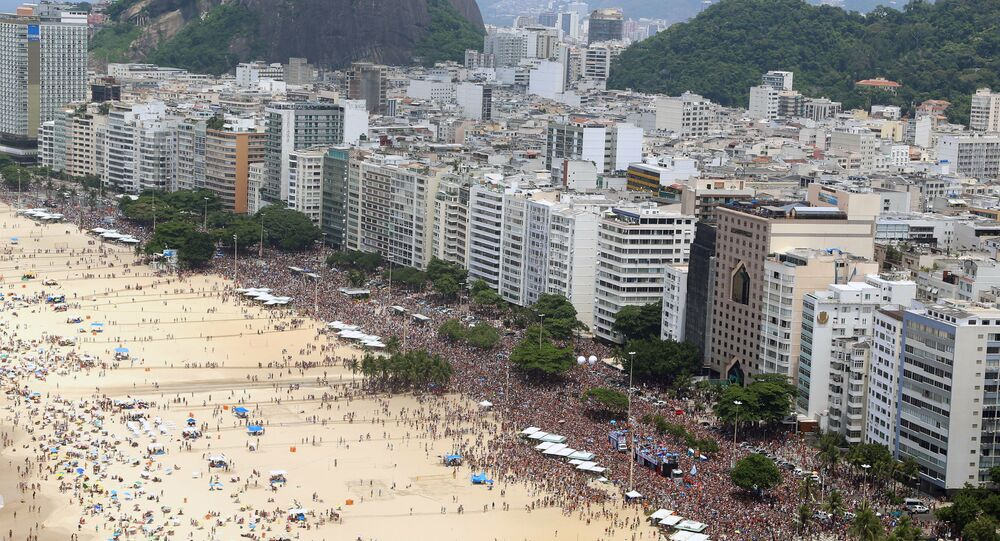 General view of revelers enjoying the A Favorita carnival band parade on Copacabana Beach, Rio de Janeiro, Brazil, on February 6, 2016