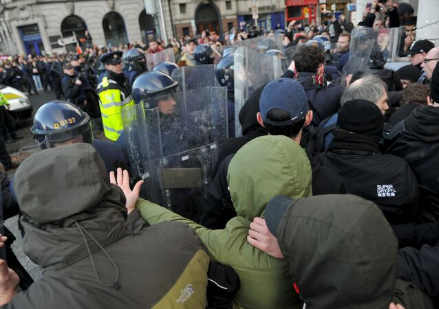 Members of the Garda Public Order Unit and riot police confront protestors at an anti-racism demonstration against the launch of an Irish branch of PEGIDA in Dublin, Ireland