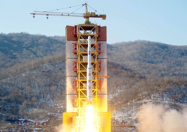 A North Korean long-range rocket is launched into the air at the Sohae rocket launch site, North Korea