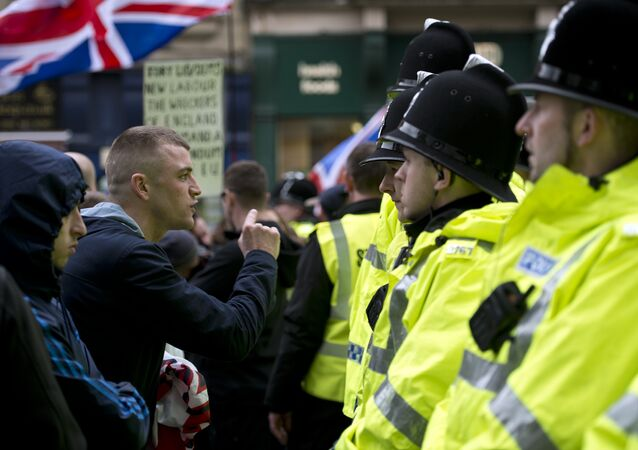 Protesters from the UK branch of the German group 'Pegida' debate with police officers in the city centre of Newcastle upon Tyne, northern England on February 28, 2015. (File)